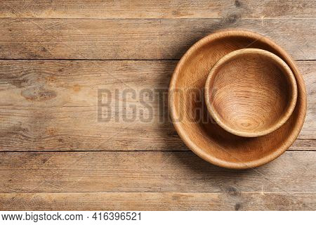Empty Clean Wooden Dishware On Table, Top View. Space For Text