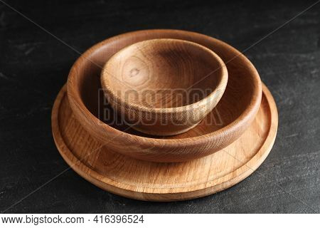 Empty Clean Wooden Dishware On Black Table, Closeup