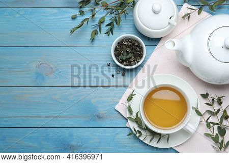 Aromatic Eucalyptus Tea On Light Blue Wooden Table, Flat Lay. Space For Text