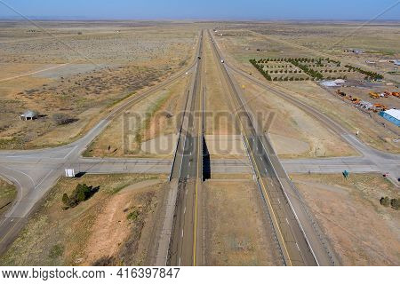 Desert Road Aerial Panorama Of A New Two Lane Road Surrounded By Desert Landscape Near San Jon New M
