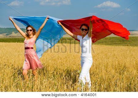 Two Young Beautiful Woman Running