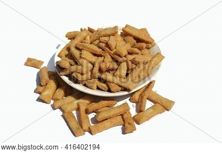 Salted Namak Para Or Nimki Indian Crunchy Savoury Snack In A Plate Isolate On White Background