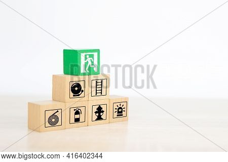 Fire, Close-up Hand Choose Wooden Toy Blocks Stacked In Pyramid With Door Exit Sing Or Fire Escape I