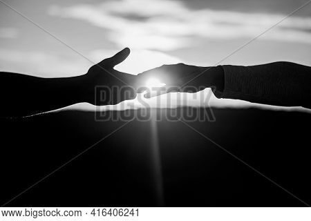 Giving A Helping Hand. Rescue, Helping Gesture Or Hands. Two Hands Silhouette On Sky Background, Con