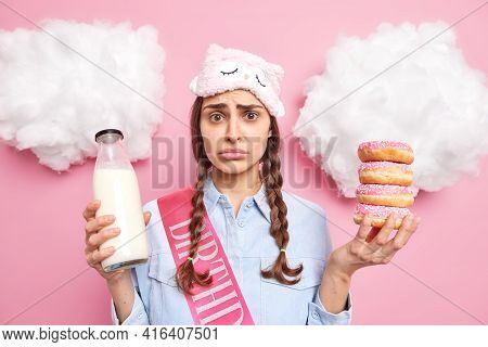 Disappointed European Girl Has Pigtails Looks With Sulking Expression Wants To Eat Baked Delicious D