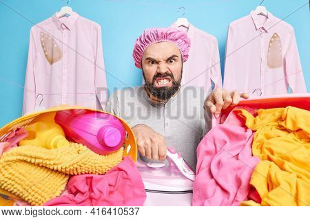 Displeased Irritated Bearded Man Clenches Teeth From Anger Being Tired Of Housework Wears Bath Hat I
