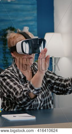 Retired Woman Experiencing Virtual Reality Using Vr Headset At Home
