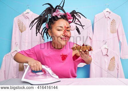 Pleased Woman Housekeeper Enjoys Eating Delicious Baked Pie Has Dirty Face And T Shirt After Cooking