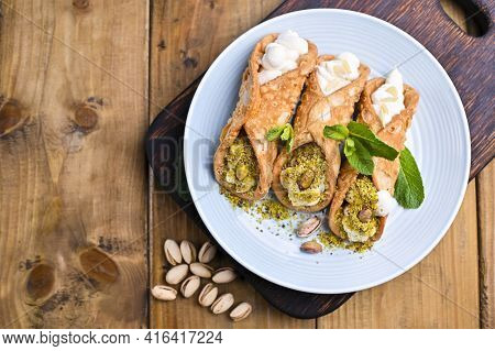 Cannoli Sicily. Traditional Italian Sweet With Ricotta And Various Fillings. Food On A Wooden Cuttin