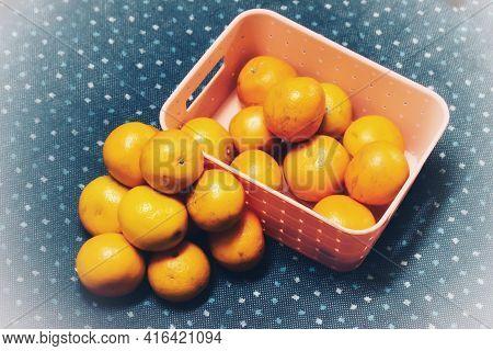 Orange Fruit With Green Leaves On The White Wood. Home Gardening. Mandarine Oranges. Tangerine Orang