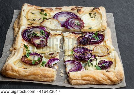 French  Onion Tart On Black Stone Background