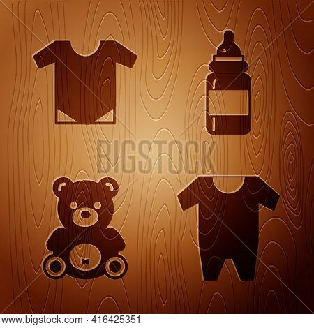 Set Baby Clothes, Baby Onesie, Teddy Bear Plush Toy And Baby Bottle On Wooden Background. Vector