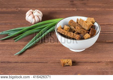 Breadcrumbs With Green Onions And Garlic On A Wooden Background