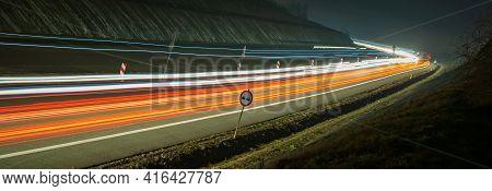 Lights Of Cars At Night. Long Exposure