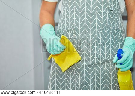 Bearded Man In Gloves With Cleaning Stuff, Rag, Disinfectant Spray Bottle In Hand