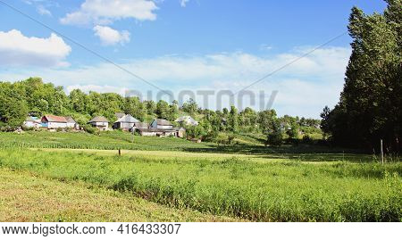 Village Panorama Spring - Spacious Green Meadow, Blue Sky With Clouds,old Style Houses. With Copy Te