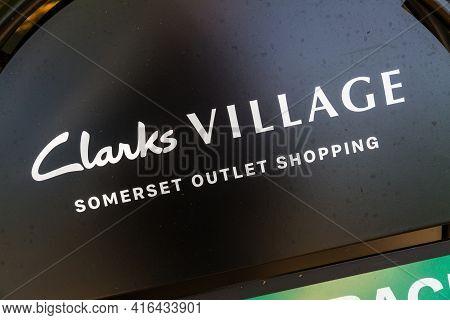 Editorial, Sign For Clarks Village Outlet Shopping Village