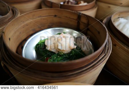 Steamed Shrimp Balls With Seaweed, Chinese Steamed Dumpling Or Dim Sum In Basket