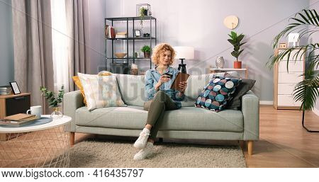 Portrait Of Beautiful Caucasian Blonde Curly Middle Age Woman Using Digital Tablet And Credit Card F