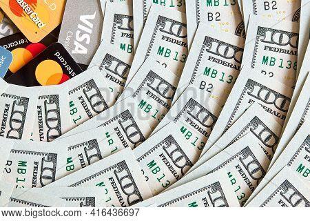 Grodno, Belarus - April 2021: A Lot Of Folded One Hundred 100 Usd Bills Layed Like Vintage Sun Beams