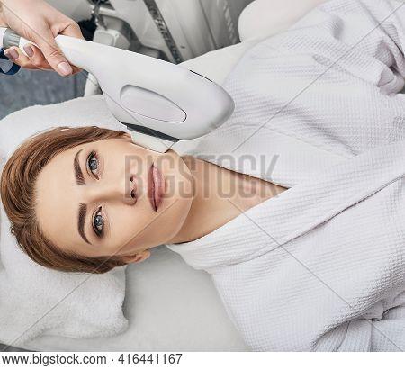 Elos Skin Rejuvenation. Woman Receives Procedure Skin Rejuvenation At A Beauty Salon With Elos Rejuv