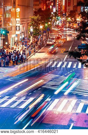 Tokyo, Japan - May, 05 2020: People And Traffic Cross The Famous Scramble Intersection In Shibuya, T