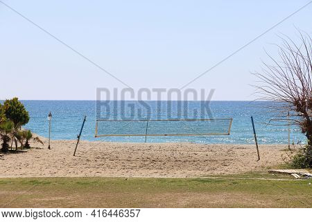A Net On A Volleyball Court On A Deserted Beach Against The Backdrop Of A Calm Sea, Alanya, April, 2