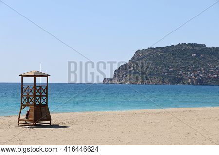 Lifeguard Booth On A Deserted Beach Against The Backdrop Of A Calm Sea And Cliffs, Minimalism, Alany