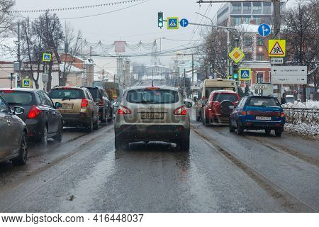Tula, Russia - February 21, 2021: Cars Stopped On Crossroads Traffic Lights At Winter Day On Main St