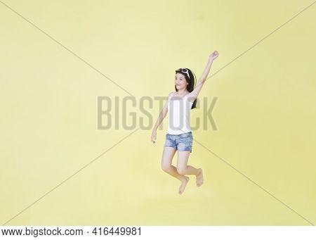 Girl Jump Hand In Mid-air