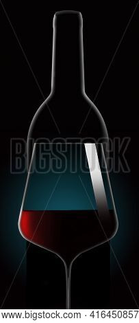 Red Wine In A Wine Glass Is Seen In Dramatic Lighting In Front Of An Unopened Wine Bottle. This Is A