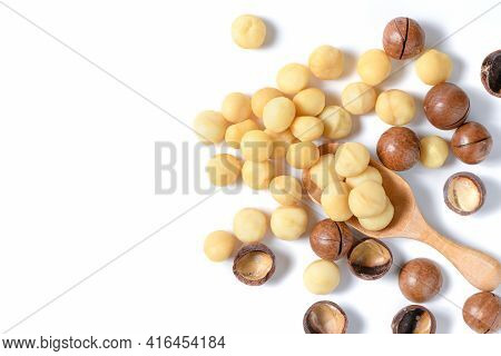 Peeled Macadamia Nuts In Wood Spoon Isolated On White Background, Macadamia Nuts Are Loaded With Fla