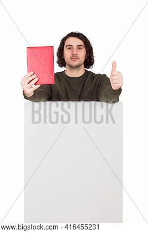 Contented Man Student Or Writer Showing A Book To Camera And Thumb Up Gesture While Standing Behind