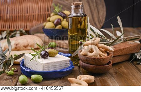 Greek Cheese With Olives And Italian And Italian Crackers Or Taralli . Fresh Olive Branches, Olive O