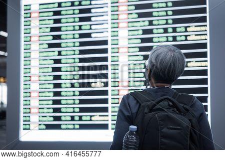 Traveler Was Cancel Flights For Stop Prevent Covid-19 Virus Disease Concept, Senior Smart Woman Trav