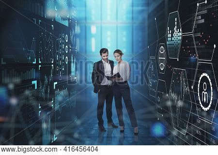 Businessman In Formal Suit And Businesswoman In White Blouse Are Standing Between Two Digital Interf