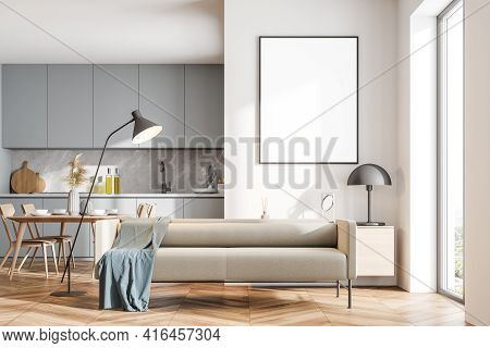 Bright Modern Kitchen Room Interior With Empty White Poster, Cupboard, Dinner Table, Comfortable Sof