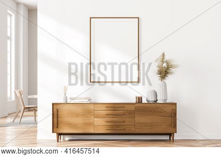 Bright Cozy Living Room Interior With Large Window, White Empty Poster On The Wall, Sideboard And Ch