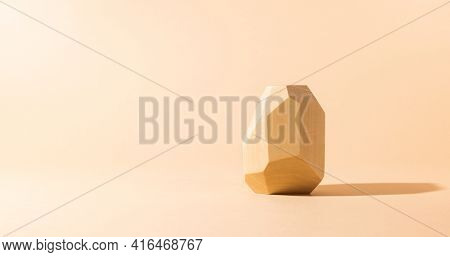 Composition of geometric balancing wooden stone. Concept of balance. Pastel background with copy space.