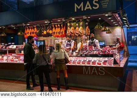 Spain, Barcelona, January, 2021 - Buyers In The La Boqueria Market Choose Spanish Iberico And Serran