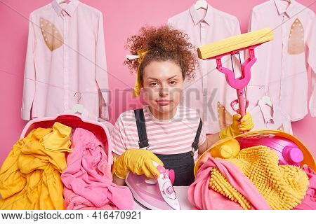 Busy Multitasking Housewife Irons Laundry Does Spring Cleaning At Home Has Tired Expression Curly Bu