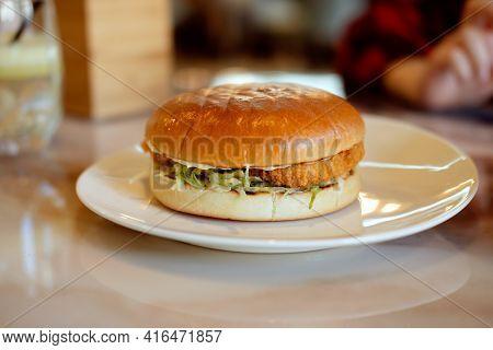 Fried Chicken Hamburger, Chicken Nugget And Fried Chicken On Wooden Plate On White Background.