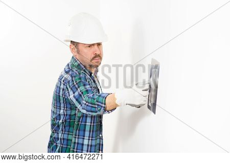 Construction Worker Wearing Safety Helmet Plastering White Wall With Decorative Filler Knife Home Re