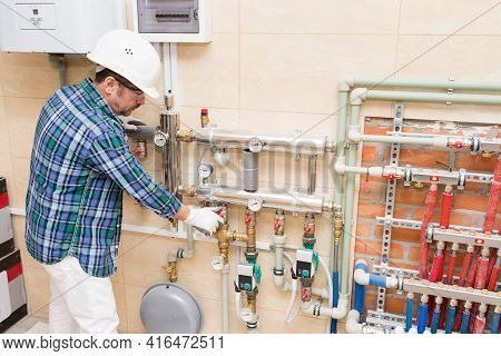 A Builder-repairman, A Plumber Is Setting Up Autonomous Heating In The House, A Water Heater, A Boil