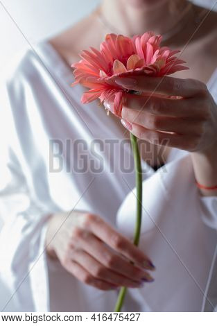 Young Woman Holding A Flower. Women's Health And Gynecology Symbol