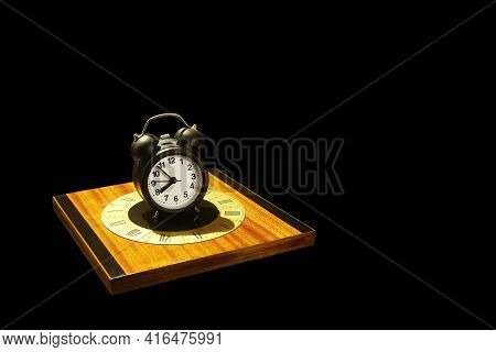 Conceptual Image Of Past And Future With An Alarm Clock On A Vintage Clock Dial. Clocks Isolated On