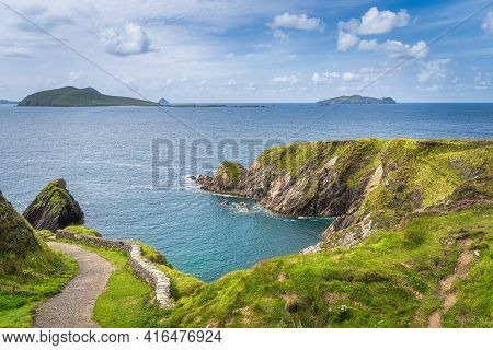 Beautiful Turquoise And Emerald Water Of Atlantic Ocean And Tall Cliffs Near Dunquin Pier, Dingle, W