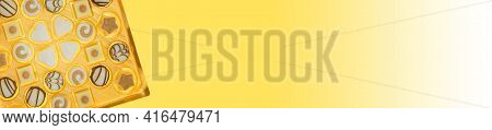 Chocolate Candies. Sweets And Chocolate Banner. Box Of Sweets Isolated On Yellow, Background.assortm