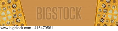 Chocolate Candies. Sweets And Chocolate Banner. Box Of Sweets On Brown Background.assortment Of Choc