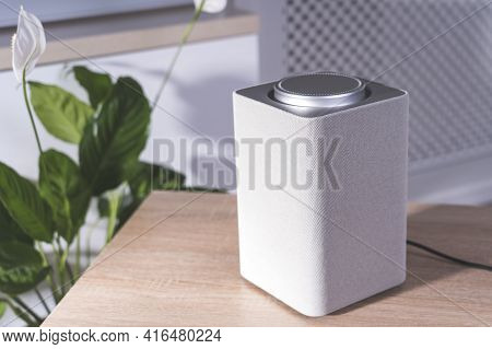 Electronic Equipment Smart Speaker On The Table In The Room And Houseplant, Smart Speaker